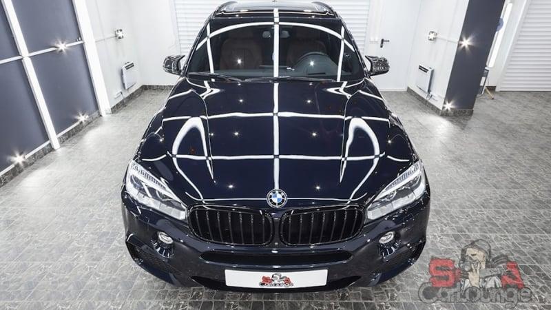 Работа с кузовом автомобиля BMW X5 полировка и восстановление ЛКП. Чистка салона и бронь фар. Обработка