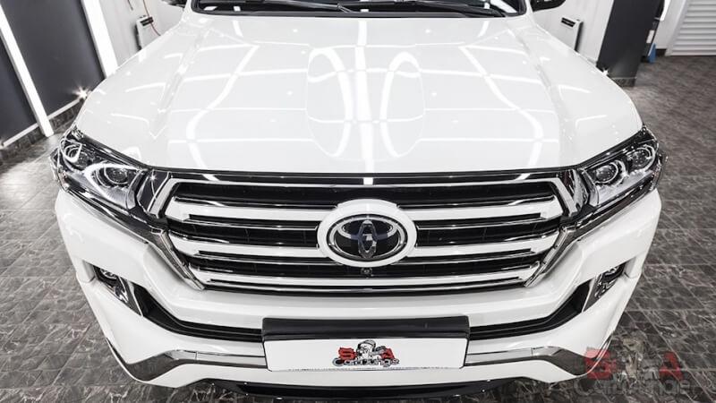 Нанесение защитной SunTek PPF Ultra на кузов автомобиля. Покрытие пленкой боковых зеркал, порогов и стоек авто. Оклеивание бамперов и порогов