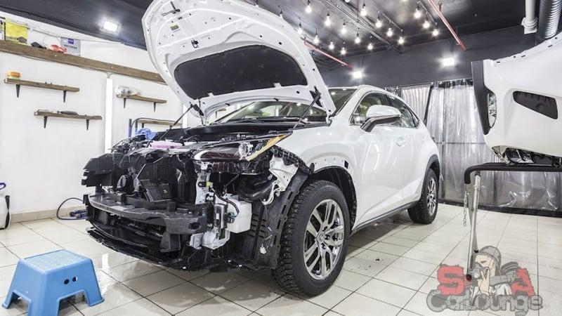 Нанесение полиуретановой премиум пленки SunTek PPFна кузов автомобиля Lexus NX. Работа с передней частью кузова, оклейка головной оптики и бампера.